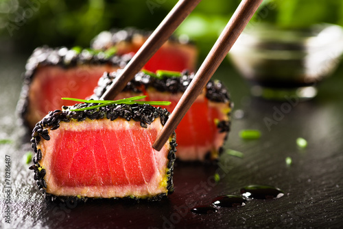 Foto op Canvas Klaar gerecht Fried tuna steak in black sesame with chopsticks