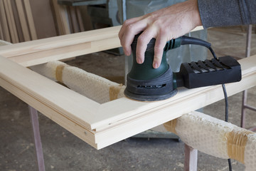 polished wood frame with hand tools