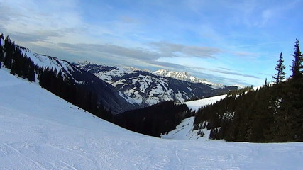 Snowboarding on snow covered mountains, pov, slow motion