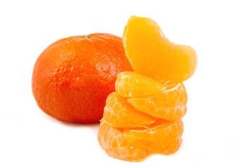 A ripe and fresh mandarin or tangerine and five stacked slices