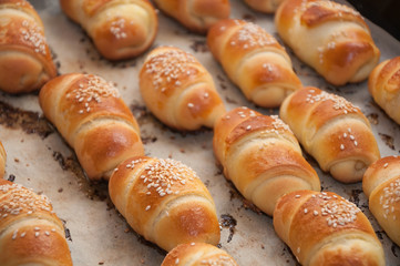 Mini croissants with cheese and sesame