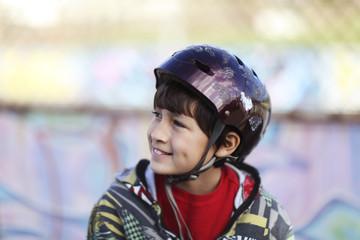 Young boy with skateboard helmet