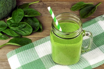 Healthy green smoothie with spinach in a jar mug