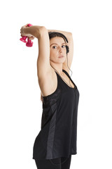 Beautiful lady trains the triceps. Isolated on white