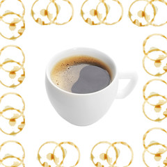 Cup of coffee in coffee stains frame isolated on white