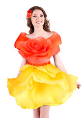 Beautiful young woman in dress made of flowers isolated on