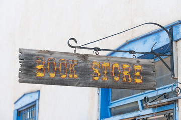 Crafted book store sign in Taos shopping center