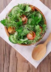 Cress salad with sliced cucumber, cherry tomatoes and parsley