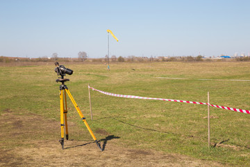 binoculars on yellow tripod