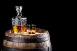 Old oak barrel and a glass of Scotch