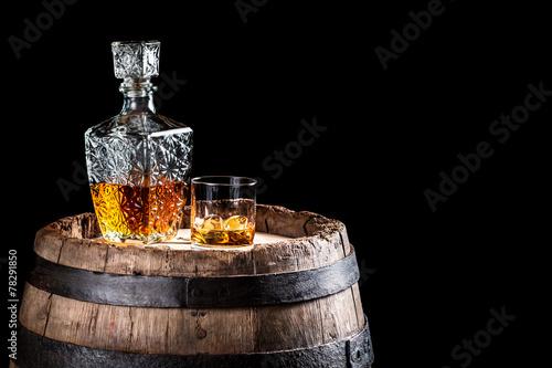 Fotobehang Alcohol Old oak barrel and a glass of Scotch
