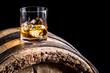 Leinwandbild Motiv Glass of whisky with ice on old wooden barrel