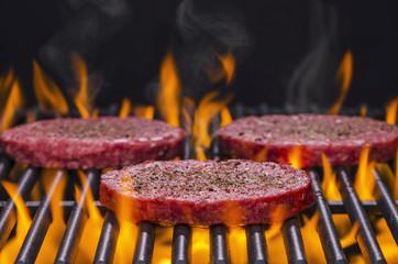 Hamburgers on a Hot Flaming BBQ Grill
