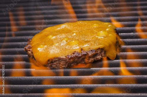 Cheeseburger  on a Hot Flaming BBQ Grill - 78292032