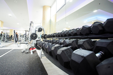 Black dumbbell in fitness room