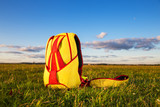 red yellow knapsack parachute into the field