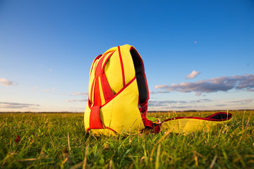 bright knapsack parachute into the field