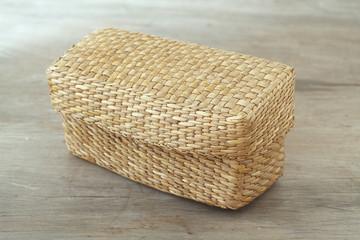 Natural basket on wooden table