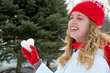 Caucasian girl with ice heart in red glove