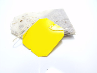 teabag with yellow label isolated on white background