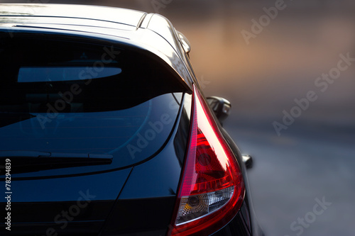 Back light of city car on the street background - 78294839