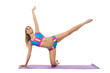 Beautiful athletic woman doing pilates exercise