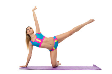 Beautiful athletic woman doing pilates exercise