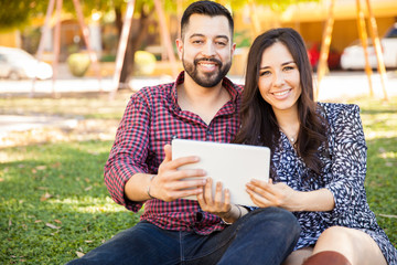 Happy couple using a tablet