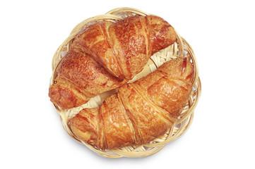 Two tasty croissants in wicker plate