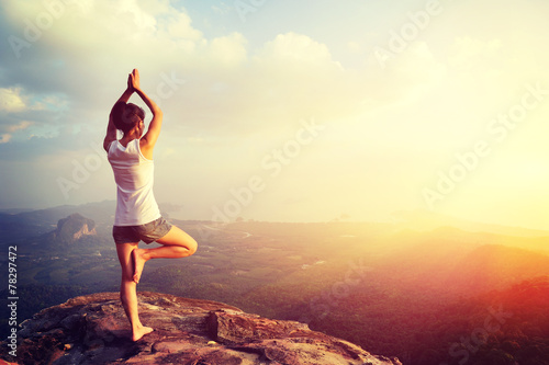 yoga woman meditation on mountain peak   - 78297472