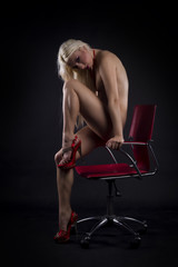Sexy nude woman on a chair