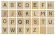 Alphabet letters on wooden scrabble pieces, isolated on white. - 78298038