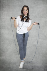 Girl with headphones and rope