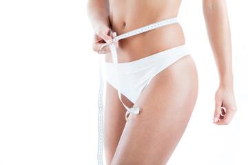 Female measuring her waist