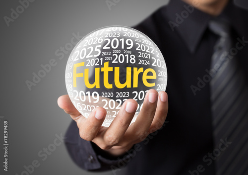 Businessman holding a glass ball,foretelling the future. - 78299489