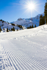 freshly groomed winter alpine ski slope
