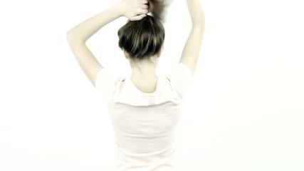 Female teenager undoing bun moving long healthy hair