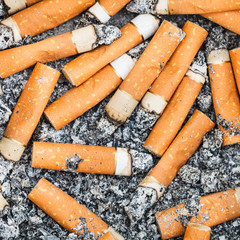 background from cigarette stubs and ash