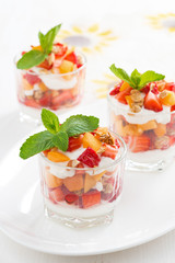 dessert with strawberries, apricots, whipped cream and mint