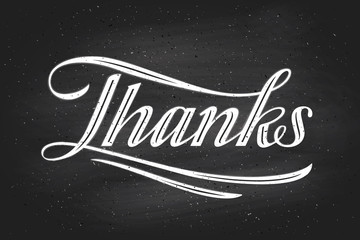 Hand lettering Thanks -Thank you- on chalkboard background
