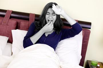 Unhappy woman taking medicine for headache