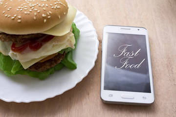 cheeseburger isolated and mobile phone