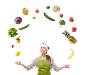 Woman cook juggling with fruits and vegetables
