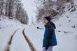 Teenager walking on wintertime