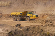 Truck and bulldozer work in the quarry - 78304486