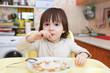 Little child eats cabbage soup