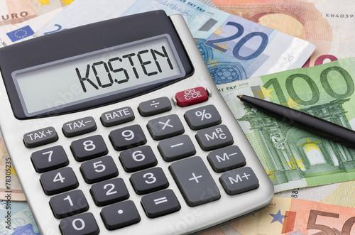 Leinwanddruck Bild Taschenrechner mit Geldscheinen - Kosten