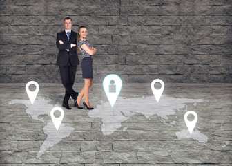 Man and woman close by each over on earth map