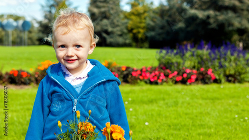 canvas print picture Little girl in the garden