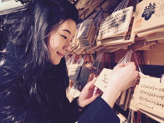 japanese girl and tablet prayer